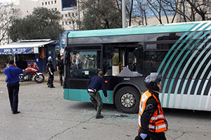 A damaged bus is seen at the scene of a bomb explosion in Jerusalem